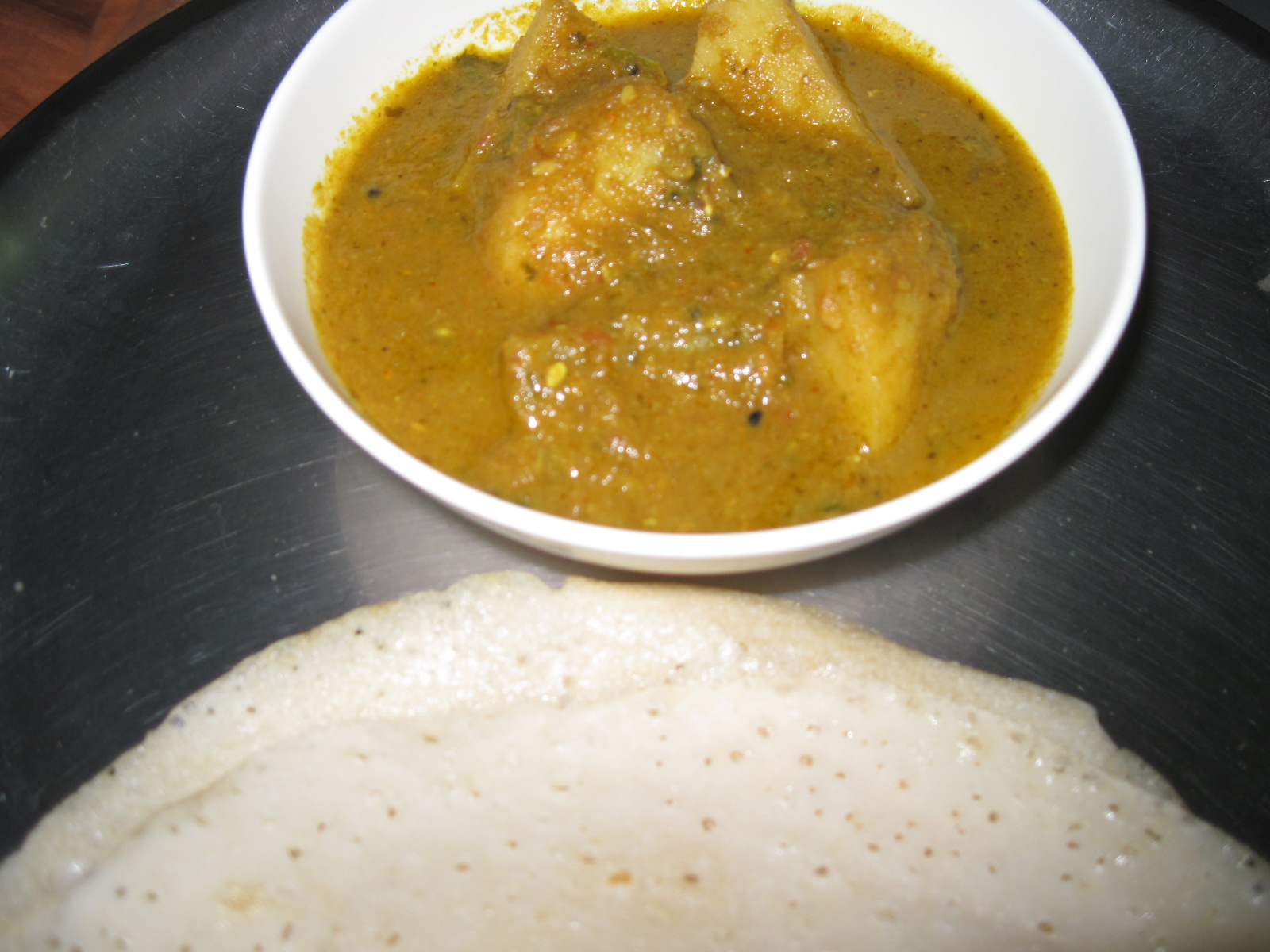 Achari Dum Alu (Potatoes steamed in a sauce of pickling spices)